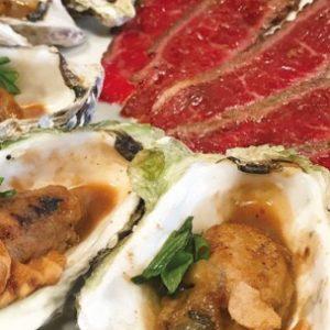 本日の熟成肉タタキと牡蠣のガーリックバターソテー